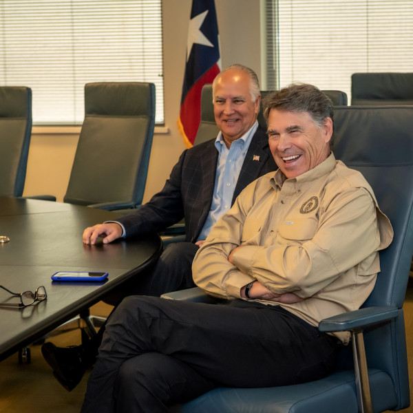 Secretary Perry during a visit to TECO as TECO Board Chair Brad Howell looked on.