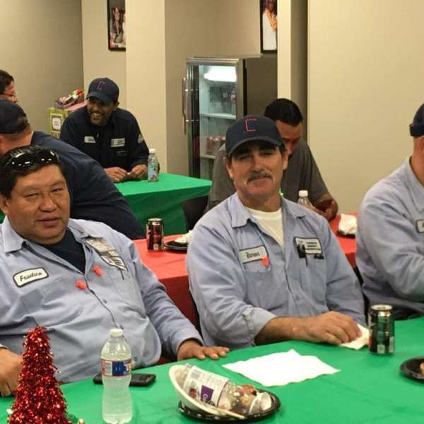Enjoying TECO's Christmas breakfast: Faustino Quiroz, Ramon Tapia, and Anthony Manning.
