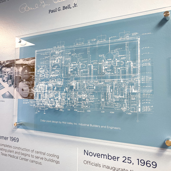 The timeline wall includes the schematic for the Central Plant's original chillers.