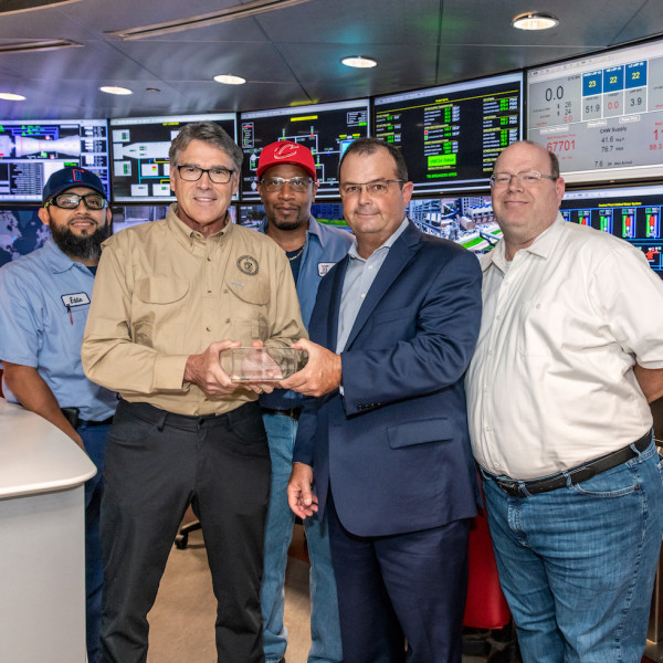 At center, TECO's Steve Swinson presents a tour memento to Energy Secretary Rick Perry, with TECO's Eddie Martinez at left and Stephen Nagy at right.