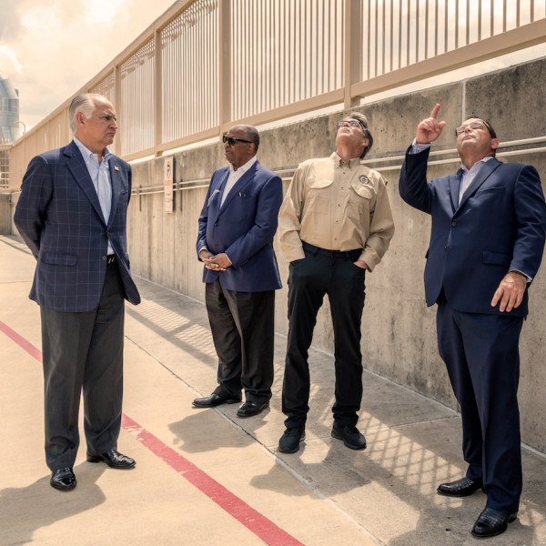Front from left, TECO's Board Chair Bradley Howell, University of Texas Regent Jodie Lee Jiles, Secretary of Energy Rick Perry, TECO President and CEO Steve Swinson tour TECO's plant site.