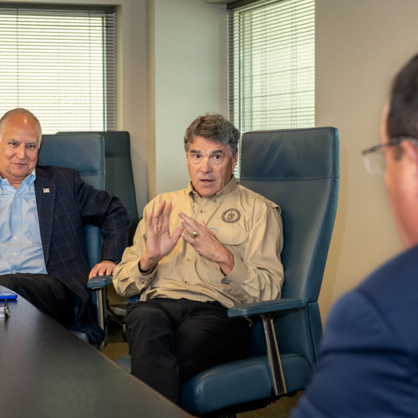 Secretary of Energy Rick Perry conversed with TECO's Board Chair Brad Howell, left, and TECO President and CEO Steve Swinson, right.